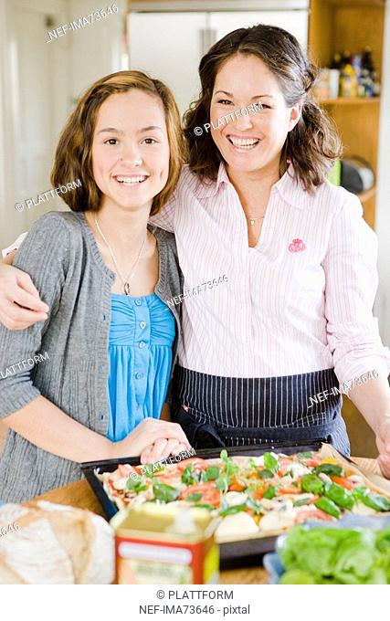 Mother and daughter cooking, Sweden