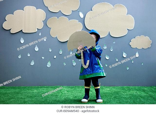 Baby girl with umbrella and rain cutouts