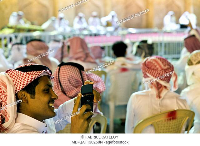 Qatar - Doha - Souq Waqif - Qatari recording an outdoor concert with mobile phones