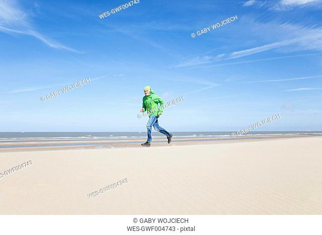 Mature man running on beach