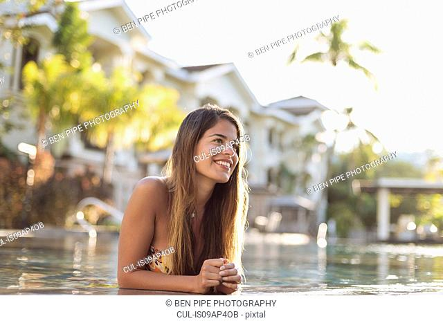 Young woman at swimming pool, Panay Island, Visayas, Philippines