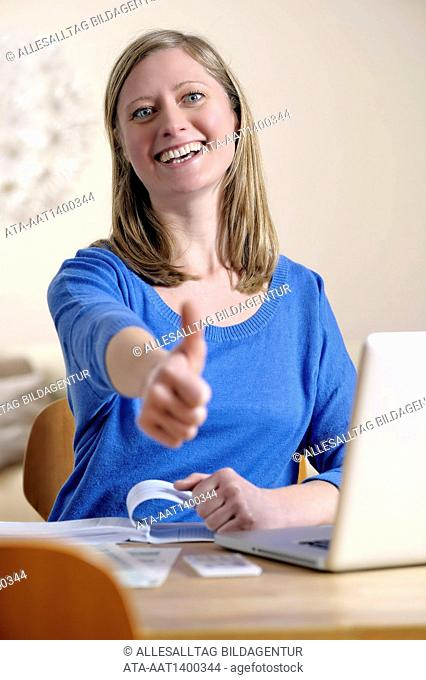 Satisfied woman is working with her notebook