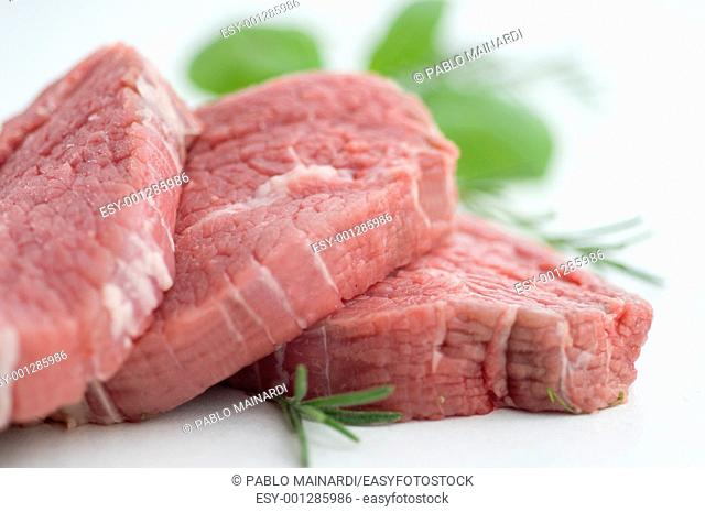 close up of raw steaks