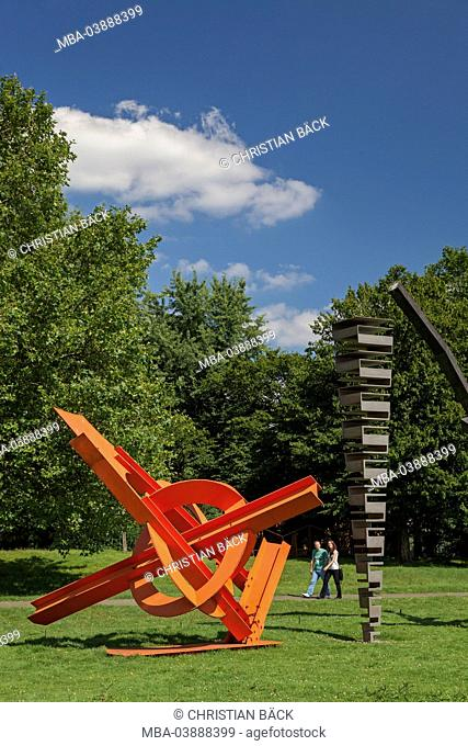Sculptures of Anish Kapoor, Tobias Rehberger and Mark di Suvero in the sculpture park Cologne Riehl, North Rhine-Westphalia, Germany