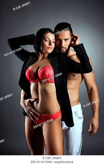 Passionate man embracing his tender mistress