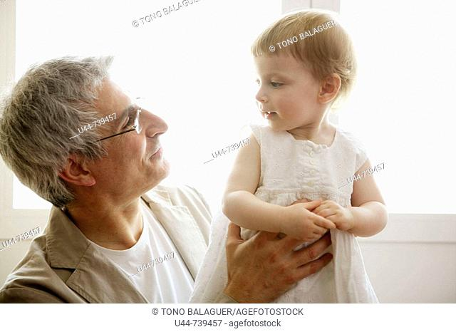 Grandfather holding his granddaughter