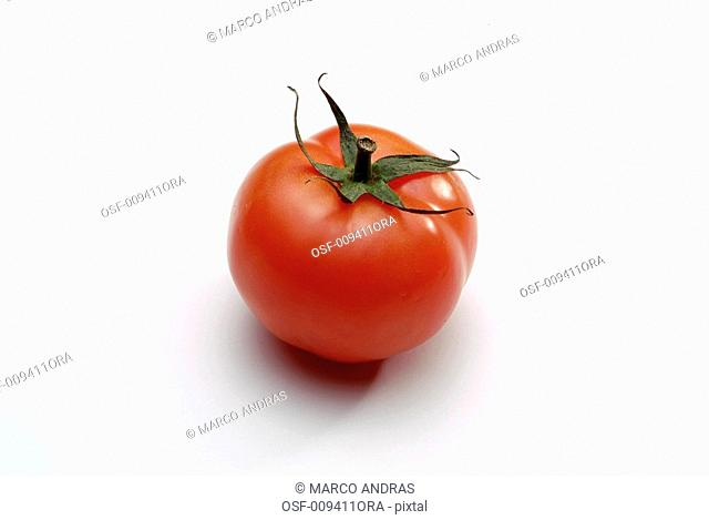 one red tomato on the table