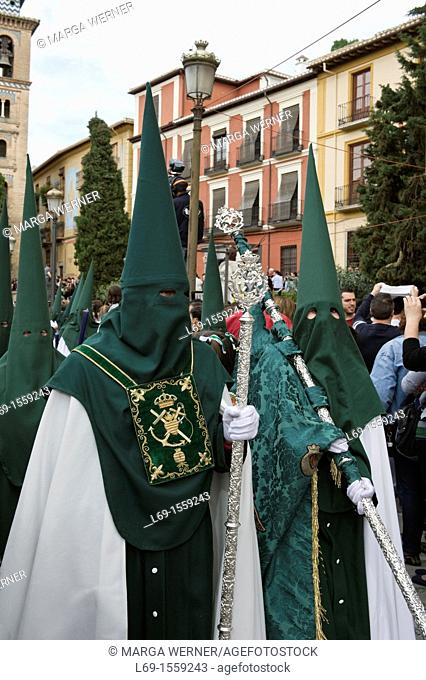Nazarenos, member of a procession during Easter week, holy Tuesday, Granada, Andalusia, Spain