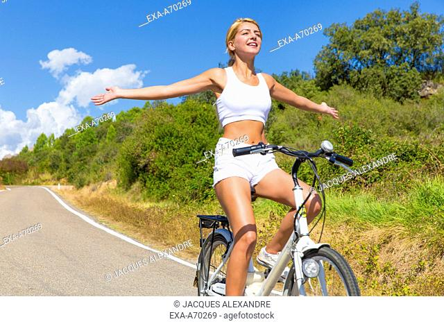Woman driving bicycle