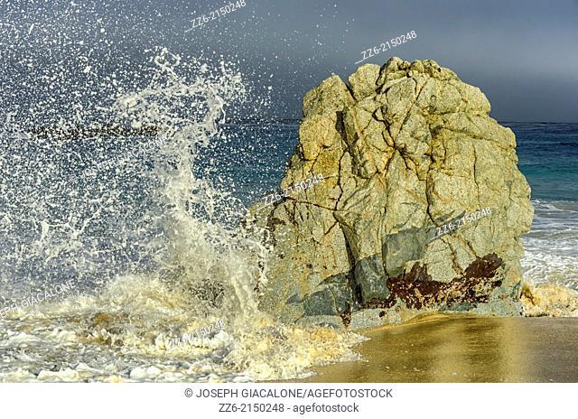 A wave impacting a rock on Garrapata State Beach. Monterey coast, California, United States