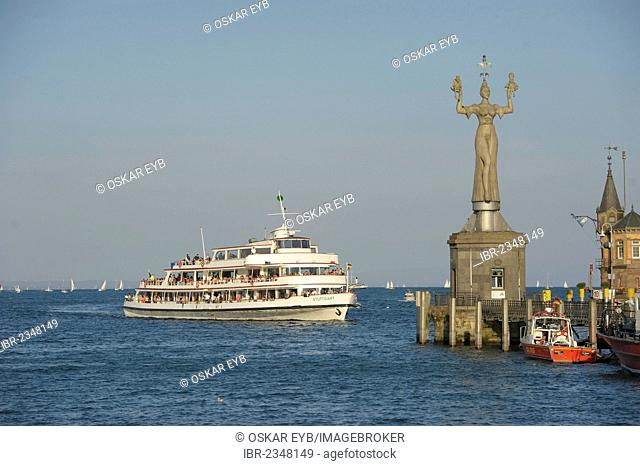 Ship entering the Lake Constance harbour entrance with the Imperia statue by sculptor Peter Lenk, Konstanz, Baden-Wuerttemberg, Germany, Europe