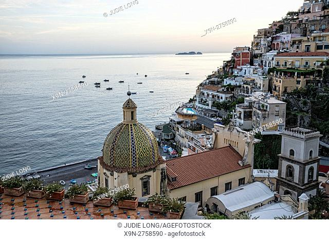 Looking Down at Chiesa di Santa Maria Assunta, a Church with a Majolica-tiled dome, the beach seaa nd surrounding mountainside buildings
