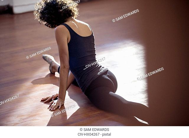 Young female dancer doing the splits in dance studio