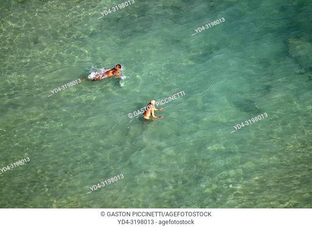 People in the beach. Aerial view of the South Coast of the island of mallorca, Balearic Island, Spain.