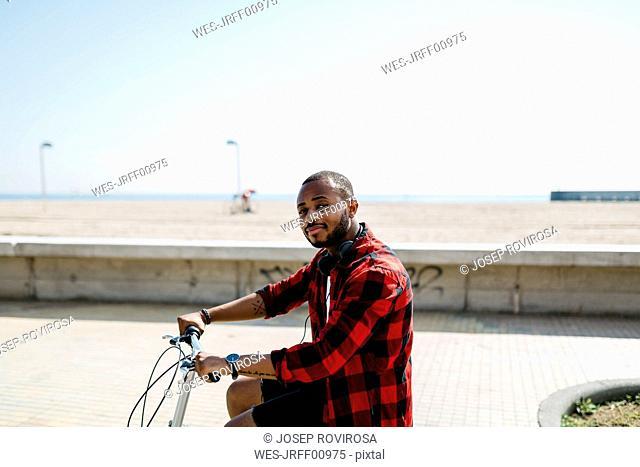 Man on bicycle near beach