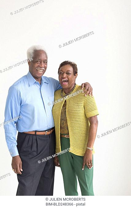 Portrait of laughing older Black couple