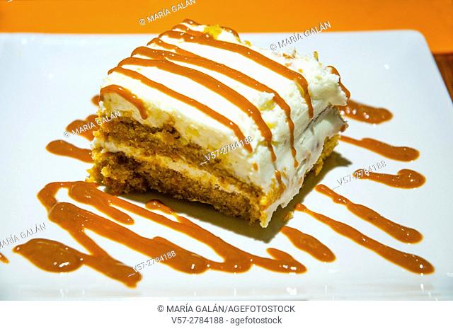 Carrot cake with toffee sauce. Close view
