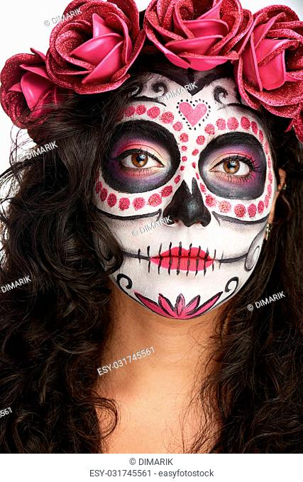 paint on woamn face of skull with red roses on head isolated white