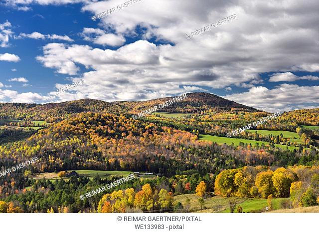 Barnet Center valley with hills in Fall colors Vermont with clouds