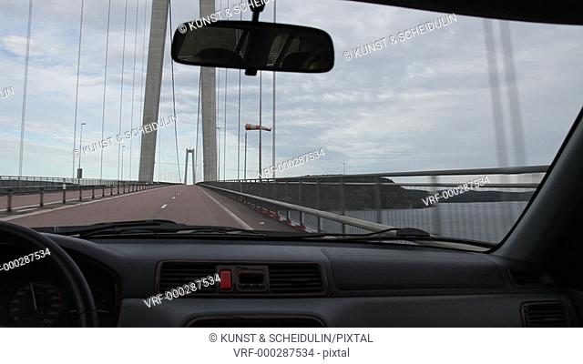 POV shot of a car driving over the High Coast Bridge (Höga Kusten Bro) over river Ångermanälv. High Coast UNESCO World Heritage site, Västernorrland, Sweden