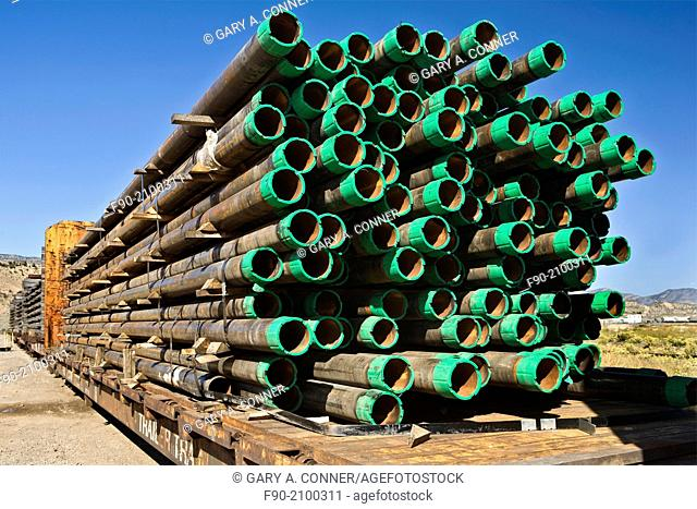 Stacked drill pipe on rail cars in Colorado
