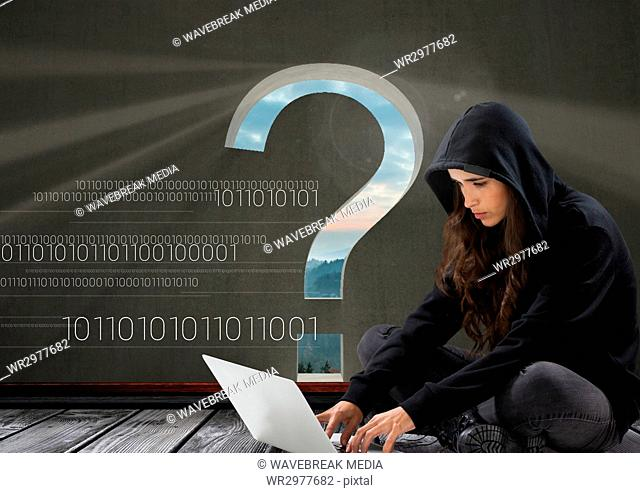 Woman hacker seated and working on a laptop with a grey background with a 3D question mark