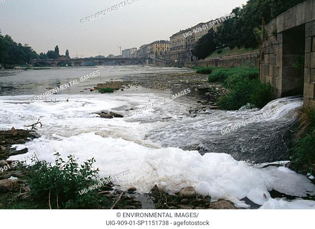 ITALY. River Po, Turin. A foamy liquid released illegally into the sewers by unknown industrial pirates emerges at the outfall in the Po at Turin