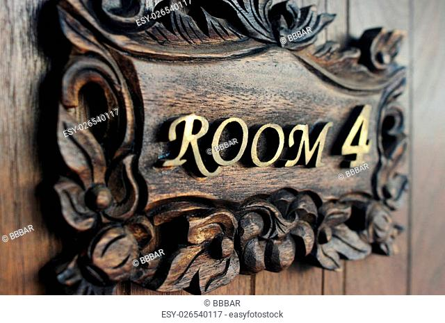 Closeup shot of a hostel door Room Number 4