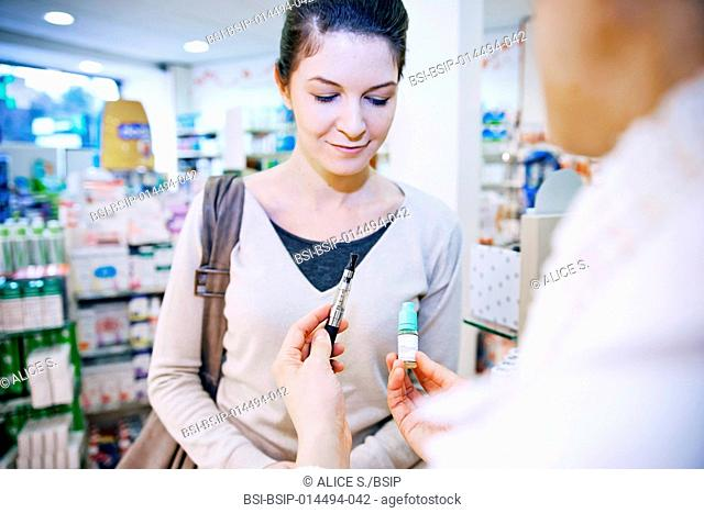Pharmacist informing a female client about e-cigarette