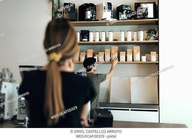 Man selling coffee in a coffee bar
