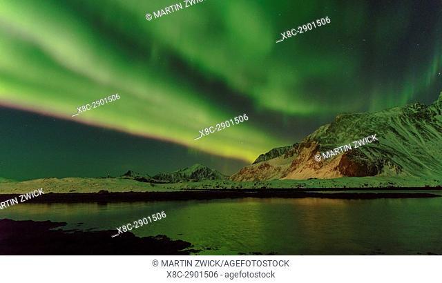 Northern Lights over Flakstadoya. The Lofoten Islands in northern Norway during winter. Europe, Scandinavia, Norway, February
