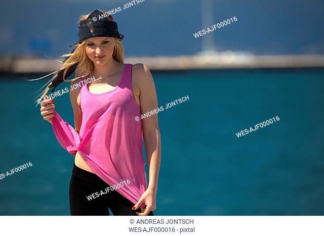 Greece, Young woman posing at sea