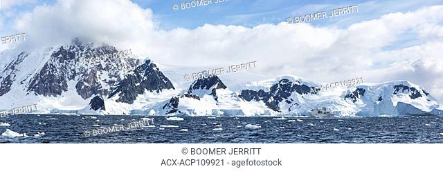 Akademic Vavilov at anchor amongst a dramatic background in Wilhelmina Bay, Gerlache Strait, Antarctic Peninsula