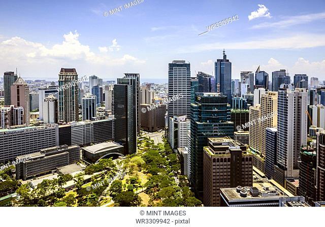 Manila cityscape under blue sky, Philippines