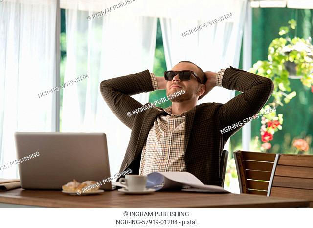 Businessman relaxing at cafe