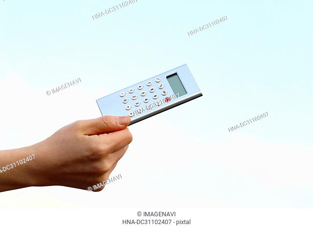 Woman Hand Holding Calculator
