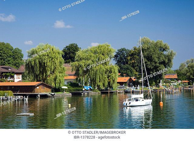 Sailboat on lakefront of Fraueninsel island, Chiemsee lake, Chiemgau, Upper Bavaria, Bavaria, Germany, Europe