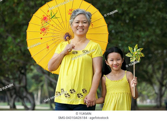 Older woman with young girl holding a pinwheel