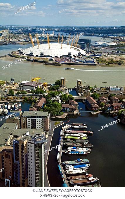 View of London skyline looking towards Poplar Wharf and Marina, O2 Arena and Thames Barrier, Canary Wharf, London, England, UK