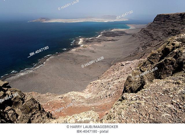 View from the Famara cliffs, Risco de Famara, of Playa del Risco beach and Isla Graciosa, Lanzarote, Canary Islands, Spain