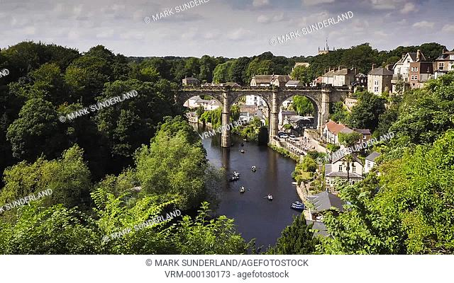 Time lapse video of the viaduct and busy River Nidd on a Saturday afternoon in summer at Knaresborough in North Yorkshire England
