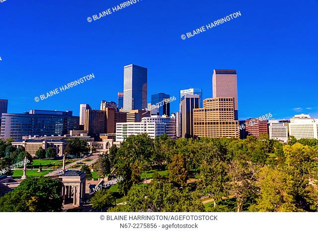 Downtown Denver skyline with Civic Center Park in foreground, Denver, Colorado USA