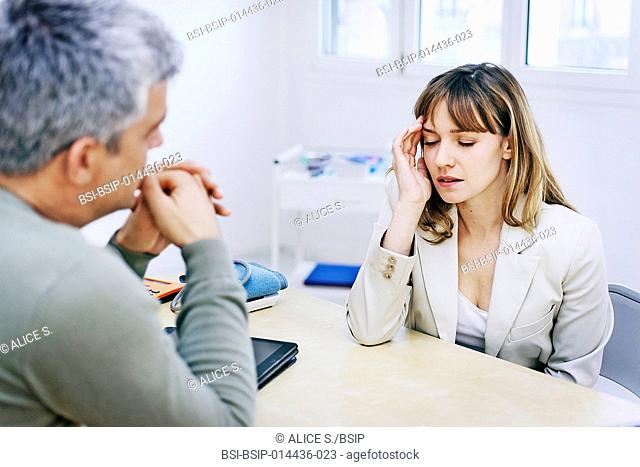 Female patient consulting for headache