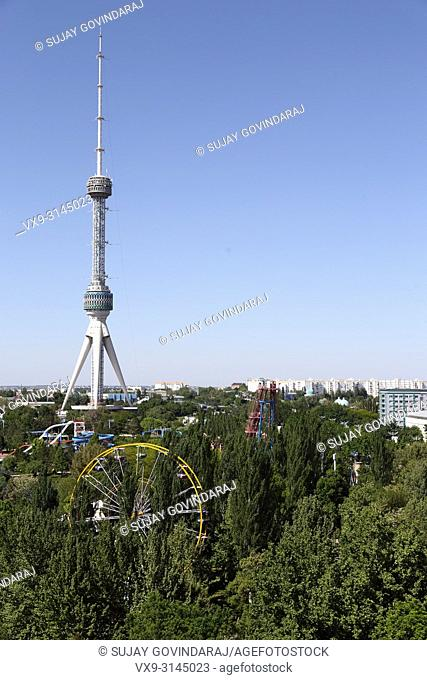 Tashkent, Uzbekistan - May 02, 2017: View of public park, urban buildings and tower in the city