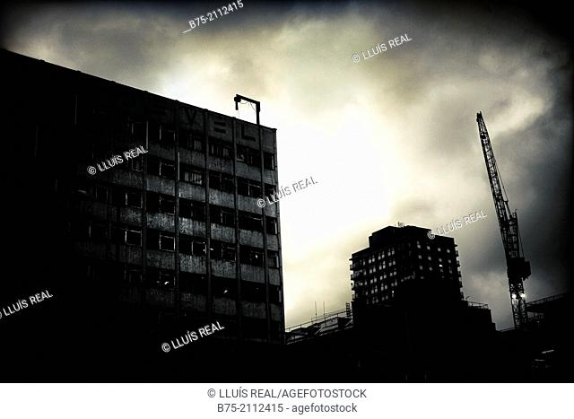 Silhouette buildings with cloudy sky at dusk in the City of London, England, UK, Europe