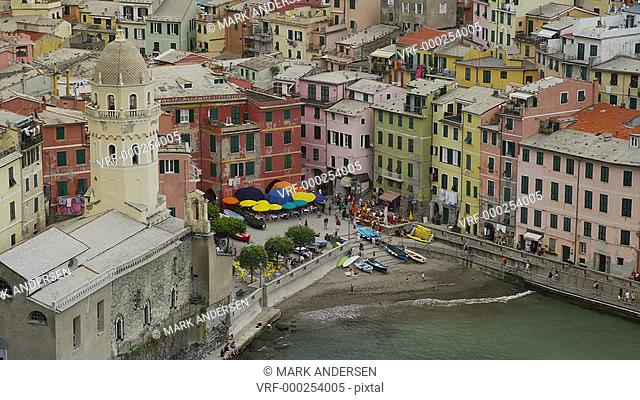 High angle panning shot of coastal village and boat ramp / Vernazza, Cinque Terre, Italy