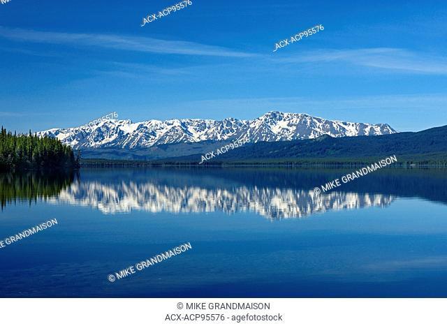 Coast Mountains reflected in Kinaskan Lake along the Stewart Cassiar Highway British Columbia Canada