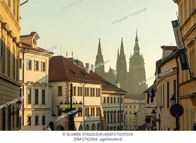 St Vitus cathedral at Hradcany looming in morning mist, Prague, Czech Republic