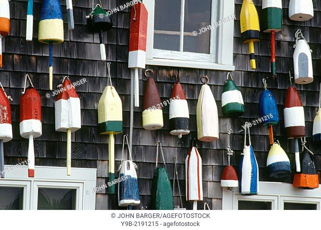 Colorful lobster floats on side of weathered building, Bass Harbor, Mt. Desert Island, coastal Maine, USA
