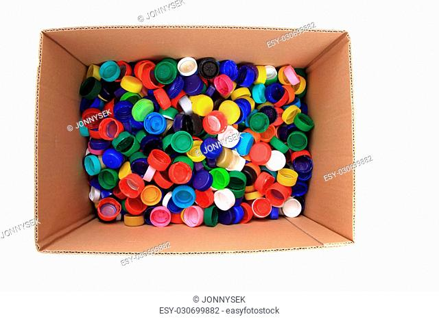 pet caps in the paper box isolated on the white background